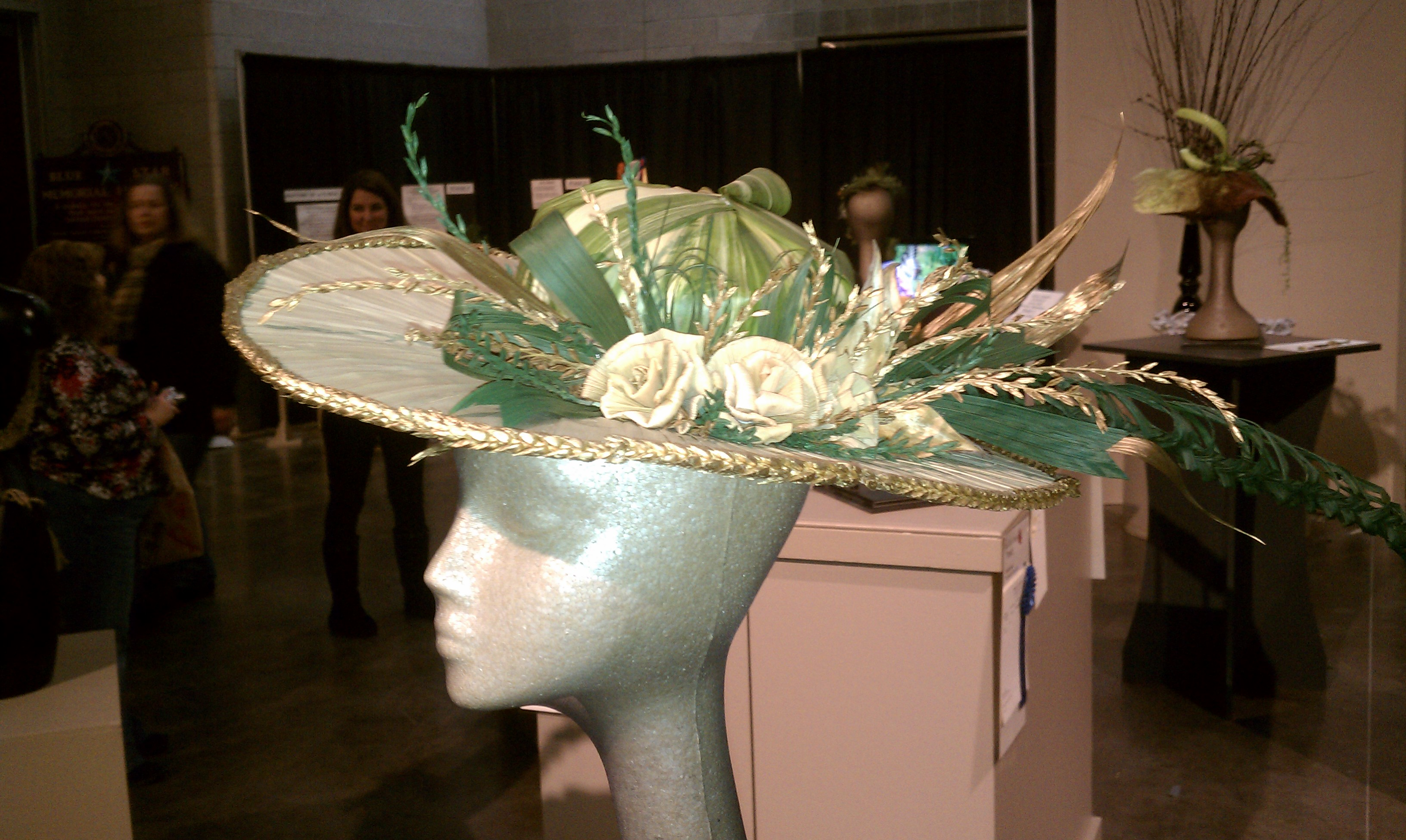 Bikinis hats and gardens on display at ri flower show for Hat display ideas for craft shows