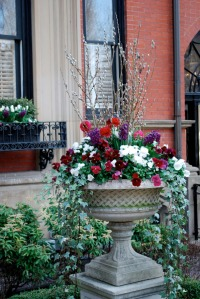 Ornate container with pansies, pussywillows and ivy
